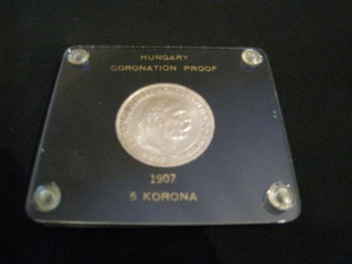 http://www.koronaportal.hu/csomagolasok/www_koronaportal_hu_ezust_5_korona_1907_capital_holder_franklin_mint_3_nagy.jpg